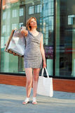 Happy young woman shopping Royalty Free Stock Images
