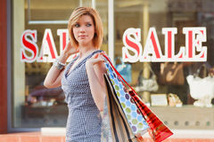 Happy young fashion woman with shopping bags Stock Photos