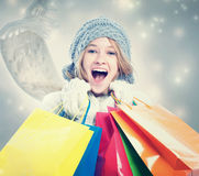 Happy Young Woman with Shopping Bag Royalty Free Stock Image
