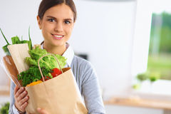 Happy young  woman with shopping bag full of Royalty Free Stock Photography