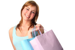 Happy young woman with shopping bags. Young woman with shopping bags psotive and happy Royalty Free Stock Images