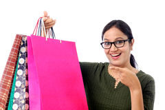 Happy young woman with shopping bags. Against white Royalty Free Stock Photo