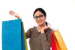 Happy young woman with shopping bags. Against white background Royalty Free Stock Photos