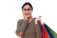 Happy young woman with shopping bags. Against white background Royalty Free Stock Photography