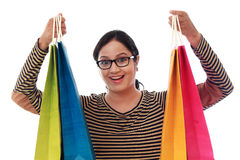 Happy young woman with shopping bags. Against white background Stock Photography