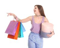 Happy young woman with shopping bags and boxes. On white background Stock Image