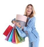 Happy young woman with shopping bags and boxes. On white background Stock Photo