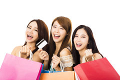 Happy young woman with shopping bags and credit card Royalty Free Stock Image