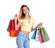 Happy young woman with shopping bags. On white background Stock Images