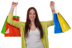Happy young woman with shopping bags. Having fun while shopping, isolated on a white background Stock Image