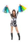 Happy young woman with shopping bags isolated Stock Images