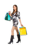 Happy young woman with shopping bags isolated Stock Image