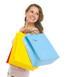 Happy young woman with shopping bags looking on copy space. Portrait of happy young woman with shopping bags looking on copy space Stock Photos
