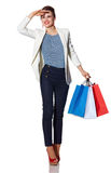 Happy young woman with shopping bags looking into the distance Stock Image