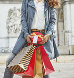 Happy young woman with shopping bags in Paris, France Stock Images