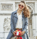 Happy young woman with shopping bags in Paris, France Royalty Free Stock Photography