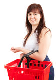 Happy young woman with shopping basket Royalty Free Stock Photo