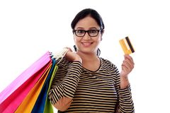 Happy young woman with shopping cards and debit card-Cashless pu. Rchase against white Royalty Free Stock Photography