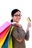Happy young woman with shopping cards and debit card-Cashless pu. Rchase, against white background Stock Photography