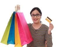 Happy young woman with shopping cards and debit card-Cashless pu. Rchase,against white background Royalty Free Stock Photo