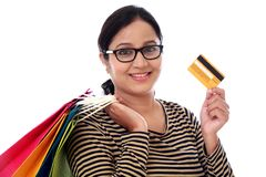 Happy young woman with shopping cards and debit card Royalty Free Stock Photo