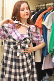 Happy young woman shopping for clothes Royalty Free Stock Image