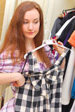 Happy young woman shopping for clothes Stock Image
