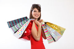 Happy young woman with shopping gift bags Stock Images