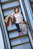 Happy young woman in a shopping mall Stock Photos