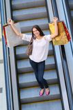 Happy young woman in a shopping mall Royalty Free Stock Photos