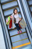 Happy young woman in a shopping mall Royalty Free Stock Photo