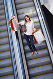 Happy young woman in a shopping mall Stock Image