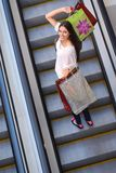 Happy young woman in a shopping mall Royalty Free Stock Image