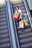Happy young woman in a shopping mall Royalty Free Stock Photography