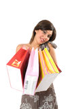 Happy young woman on a shopping paper-bag. Royalty Free Stock Photos