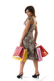 Happy young woman on a shopping paper-bag. Stock Images