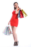Happy young woman shopping in short red dress Royalty Free Stock Photo