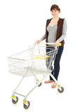 Happy young woman with shopping trolley Royalty Free Stock Photos