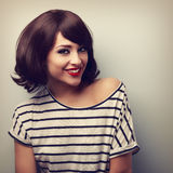 Happy young woman with short hairstyle toothy smiling. Vintage c. Loseup portrait Royalty Free Stock Images