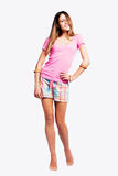 Happy young woman in shorts barefoot Stock Photo