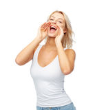 Happy young woman shouting or calling someone Stock Photos