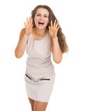 Happy young woman shouting through megaphone shaped hands Royalty Free Stock Photos