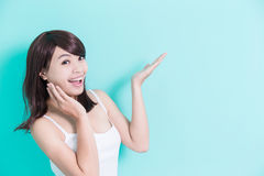 Happy young woman show something Stock Photos