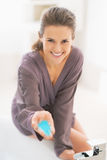 Happy young woman showing bath salt Royalty Free Stock Image