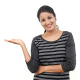 Happy young woman showing blank copy space Royalty Free Stock Images