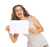 Happy young woman showing blank paper sheet Stock Photos