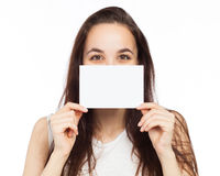 Happy young woman showing at a blank signboard Royalty Free Stock Images