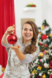 Happy young woman showing christmas ball Royalty Free Stock Photo