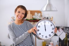 Happy young woman showing clock in christmas Royalty Free Stock Photography