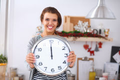 Happy young woman showing clock in christmas Stock Images